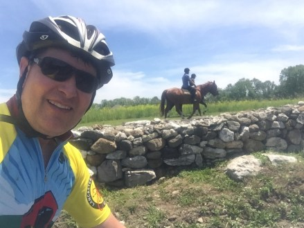 An on bike selfie with horses! Fun cycling!