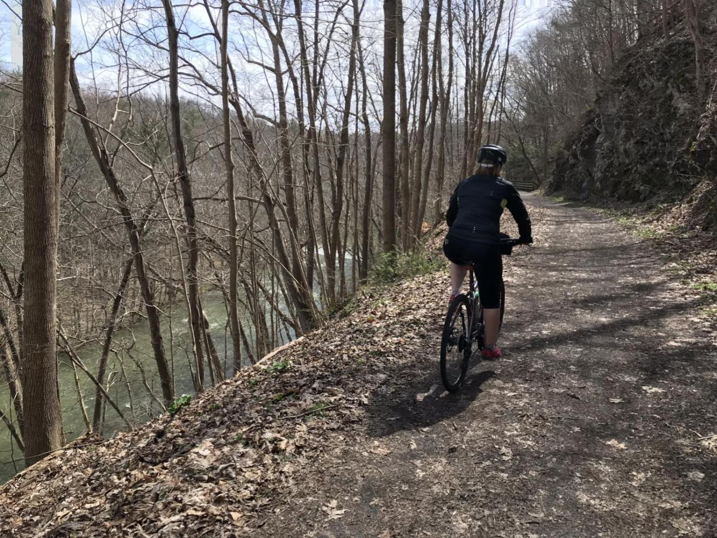 Mary rides beside the Holston River