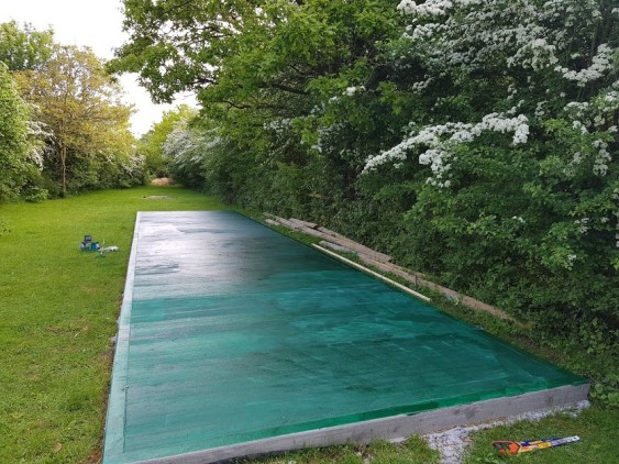The Beginning - Brand new concrete pad, built by our customer, ready for the Dog kennels and the next step.