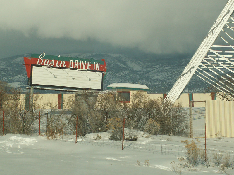 Basin Drive-In sign by snow-covered ground