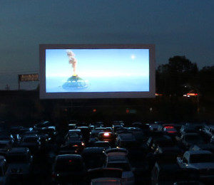 Drive-In screen with full lot at twilight