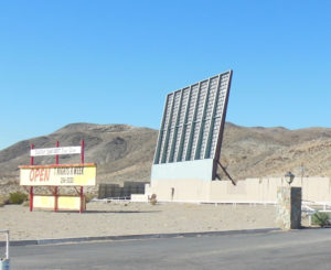 Skyline Drive-In sign and screen in the desert