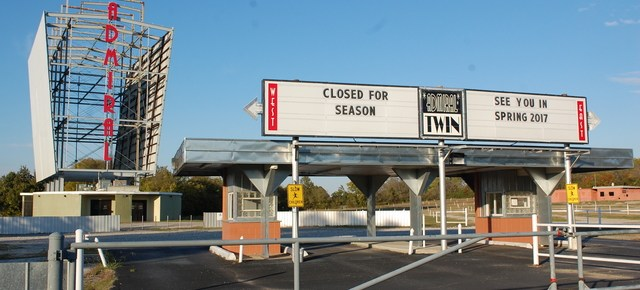 "Admiral Twin Drive-In ""Closed for the season"" with two-sided screen in background"