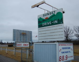 Sunset Drive-in marquee with screen in background