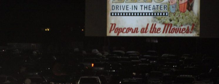 Cars watching a movie at night