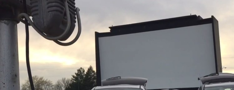 McHenry Outdoor Theatre screen with speaker pole in foreground