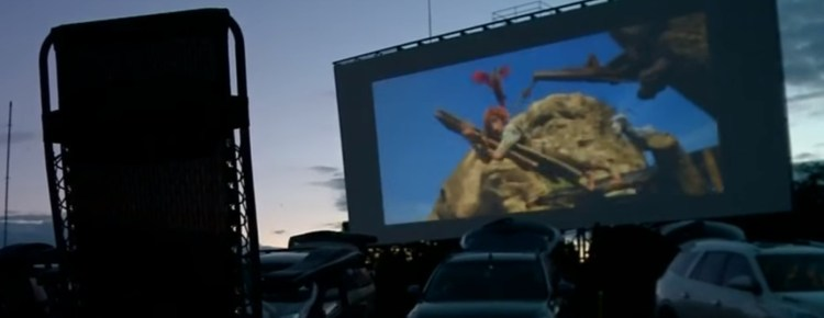 Movie on a Getty Drive-In screen with lawn chair silhouette