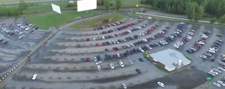 Aerial view of the two-screen drive-in with a highway in the background