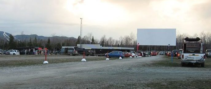 Cars at the drive-in, with a screen in the distance