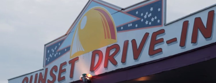 Sunset Drive-In sign above the box office