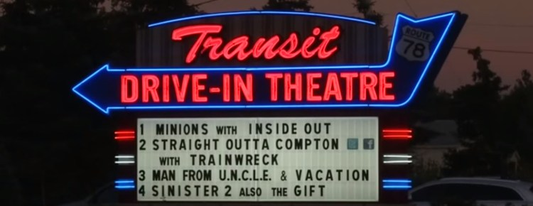 Transit Drive-In marquee lit in neon at twilight