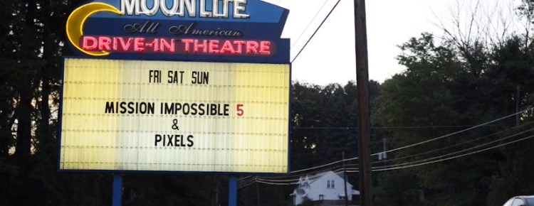 Moonlite Drive-In marquee lit at dusk