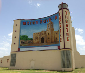 Daylight photo of the mural on the back of the screen of the Mission Drive-In Theatre