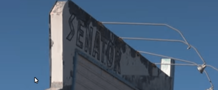 Rusted old Senator Drive-In sign
