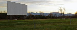 Greenwood Drive-In screen with mountain background at sunset