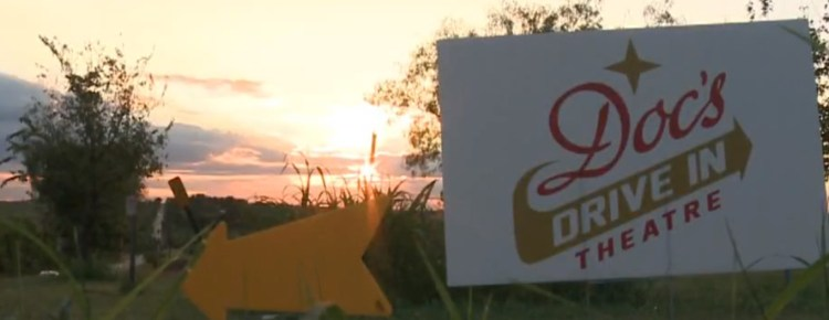 Doc's Drive-In sign and arrow at dawn