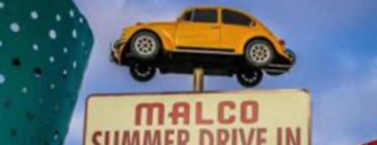 Volkswagen beetle at the top of the Malco Summer Drive-In sign