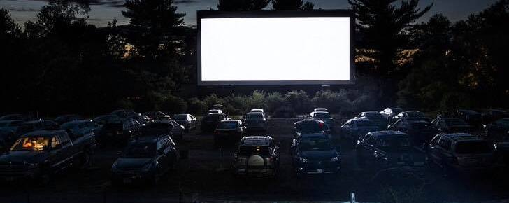 The Havelock Family Drive-In screen at night with cars