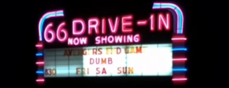 Neon-lit 66 Drive-In marquee at night