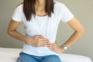 Woman experiencing pain from a hernia
