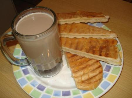 Image result for cafe con leche y pan con mantequilla