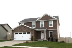 driftwood-roof-white-trim-carriage-style-garage-door-royal-natural-cedar-vertical-siding-normal-il-blackstone