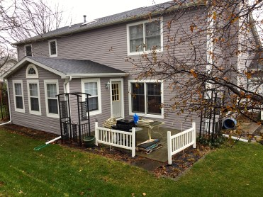 House with grey siding and white trim