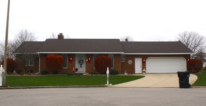 Ranch brick house with new roof that compliments brick color