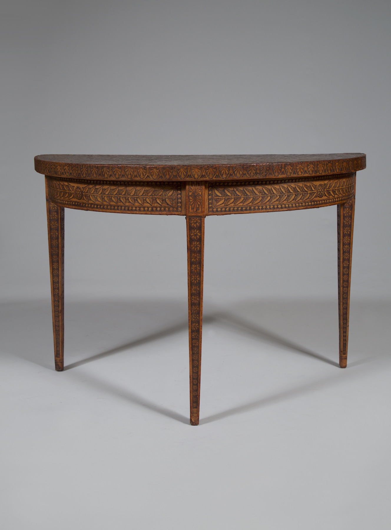 11339 U2013 A MOST UNUSUAL DEMILUNE CONSOLE TABLE ALL COVERED IN FINELY WORKED  LEATHER | Carlton Hobbs New York