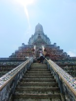 Climing the steep steps up Wat Arun