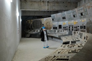 Stanislav Shekstelo, an employee of the Chernobyl Nuclear Power Plant, contemplates the remains of the Unit 4 control room.