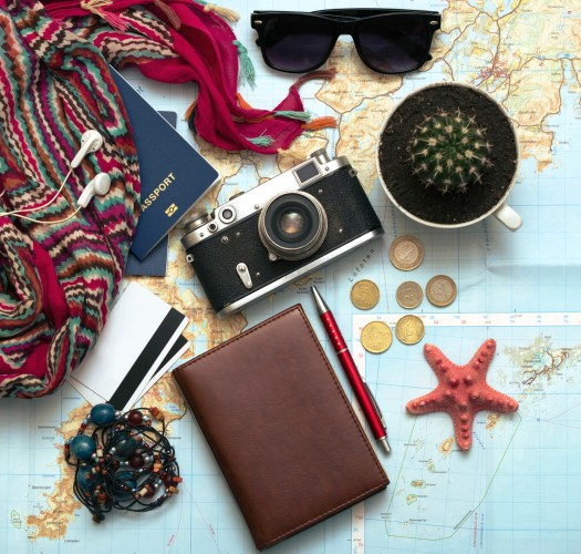 background - what to take for a trip. passport, documents, car keys, map, camera, money, sunglasses, credit cards, accessories