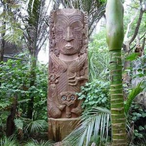 A Māori pouwhenua or pou (carved pillars) in Auckland Zoo.