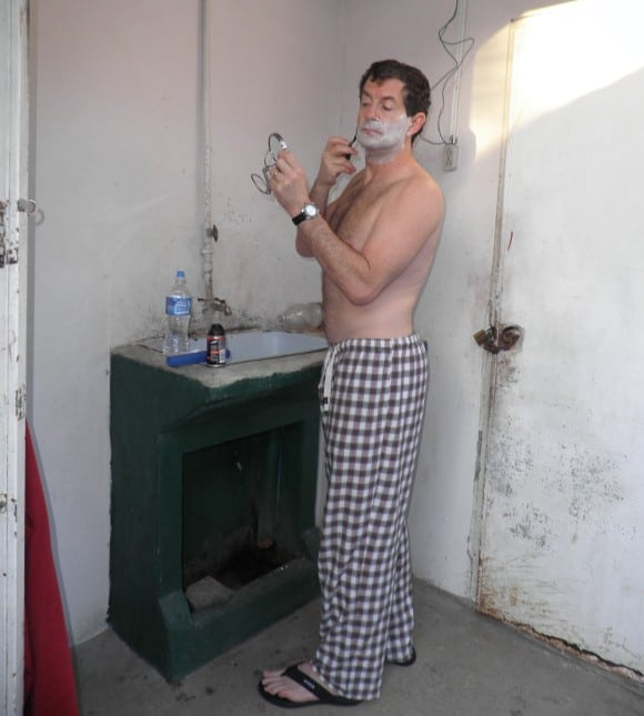 My husband trying to shave in our relatives house in Havana