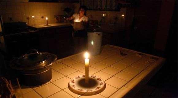 Woman preparing dinner in her kitchen in the dark