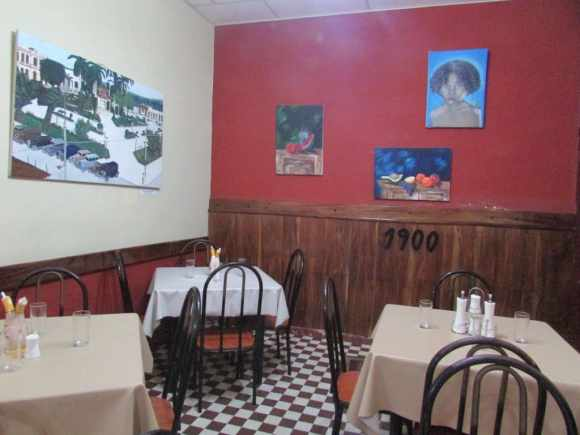 """1990's Restaurant"""" in Placetas. The walls are decorated with some paintings by local artists"""