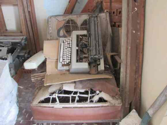 The room of broken chairs and typewriters in Civil Registry of Placetas<