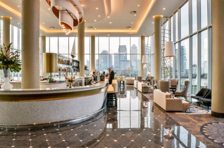 The Clipper Bar with floor to ceiling windows overlooking Canary Wharf and the River Thames at InterContinental London - The O2