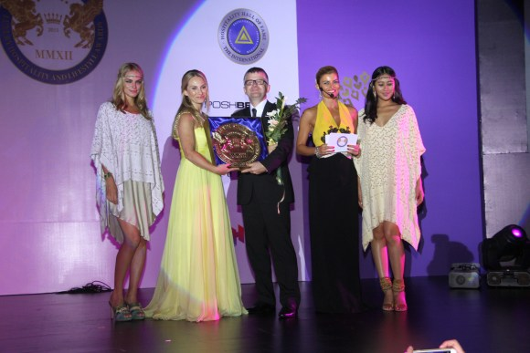 Mrs Nicola El-Mouelhy-VP SSLHLA , Ms Ece Vahapoglu presenting an award on stage at The Seven Stars Luxury Hospitality And Lifestyle Awards in Bali 2015