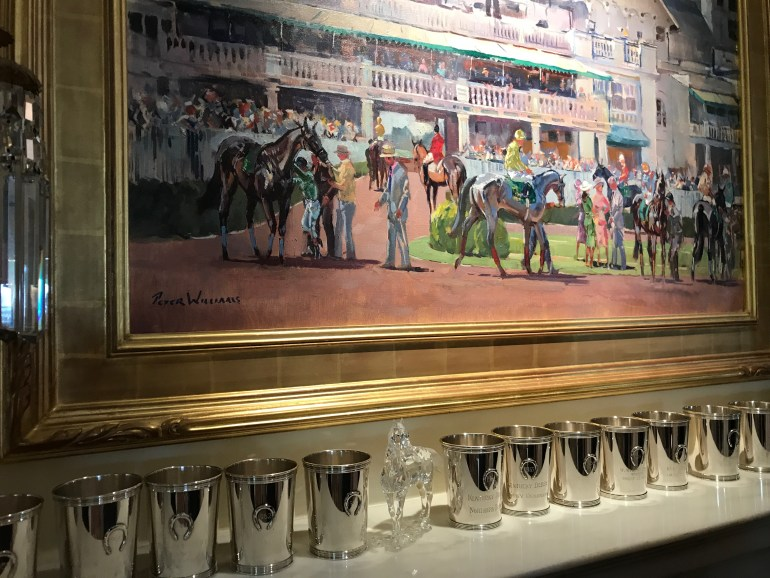 Mantel filled with Kentucky Derby Mint Julep Silver Cups