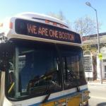 """Bus displaying the message, """"We Are One Boston""""."""