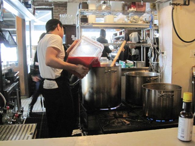 pot pouring pasta sauce
