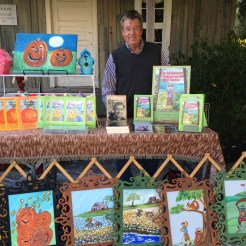Rod Ragsdale and his book booth of The Adventures of Andrew on the Golf Course