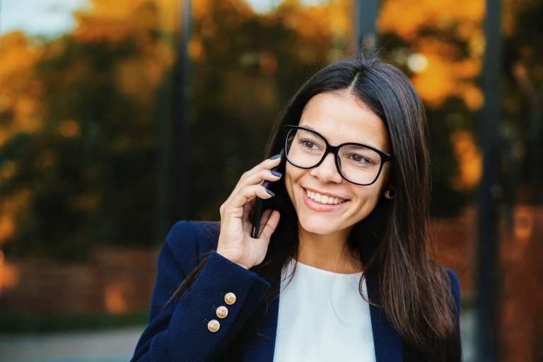 woman smiling on phone