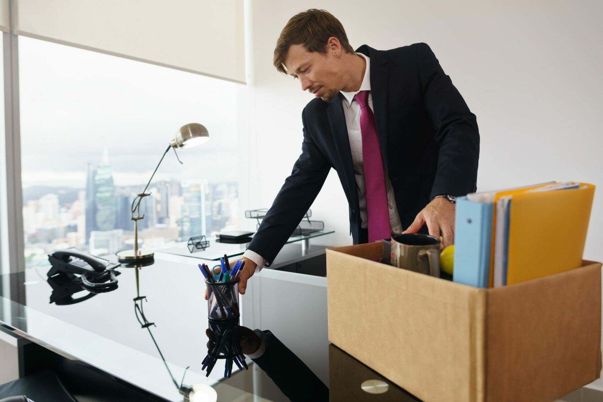 man packing up his office