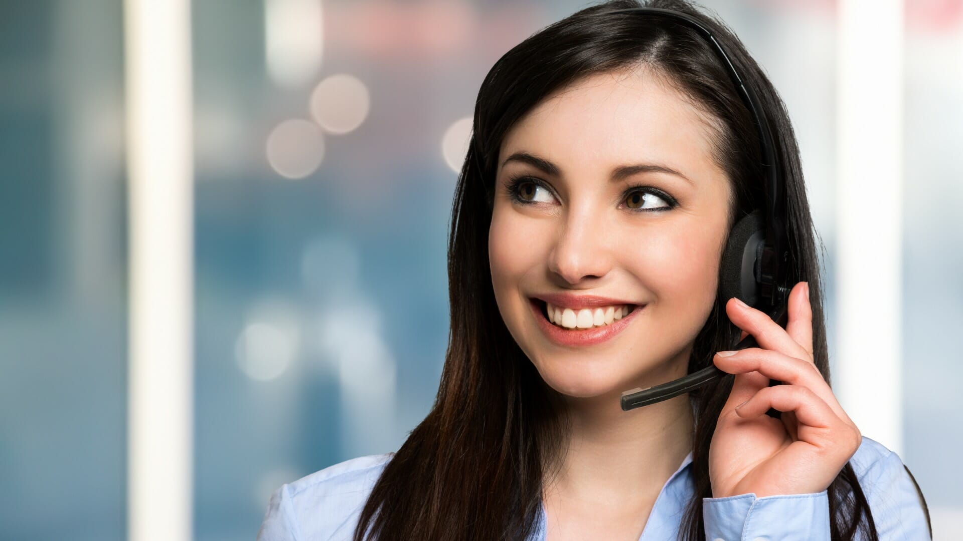 woman smiling with headset - No Longer Tied to a Desk - Carolina Digital Phone - LDR & Co.