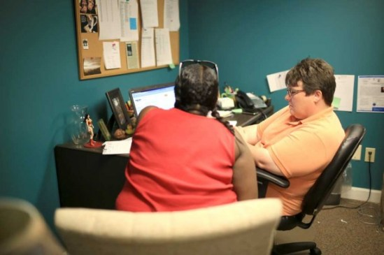 Women at Risk counselor/case manager Angie Buchanan searches an online job board with a client on Monday, July 22.  Women at Risk strives to help keep women out of jail via counseling/treatment, therapy, case management, job search, and court advocacy. Colby Rabon/Carolina Public Press