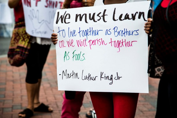 Protestors held signs calling for police demilitarization and racial justice. Alicia Funderburk/Carolina Public Press