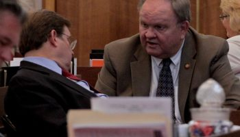 Rep. Chuck McGrady confers with Rep. Nelson Dollar during N.C. House budget discussions in June 2017.