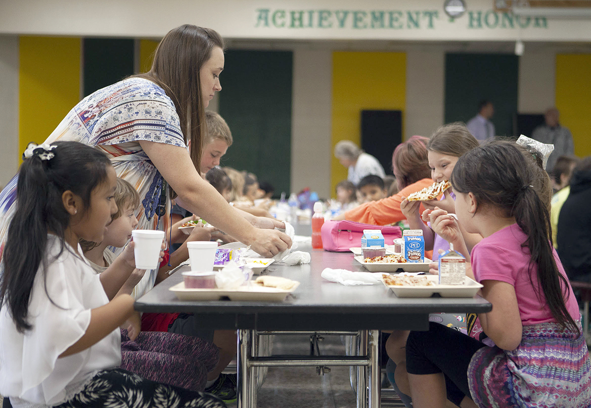 Kari Read hands out meals to first-graders at Blue Ridge School in Cashiers.